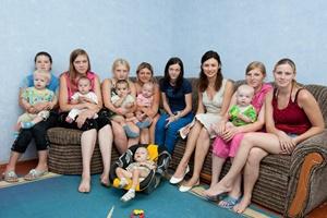 Olga Kurylenko at a mother and baby home