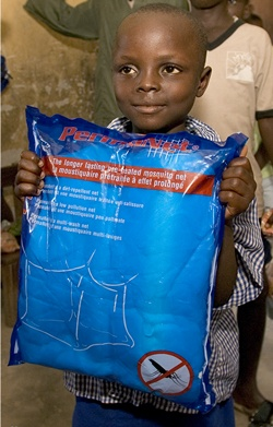 A child receives an anti-malaria net
