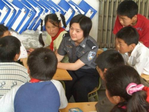 Volunteer from Chinese People's Public Security University with migrant children – part of an education programme supported by the Narada Foundation.