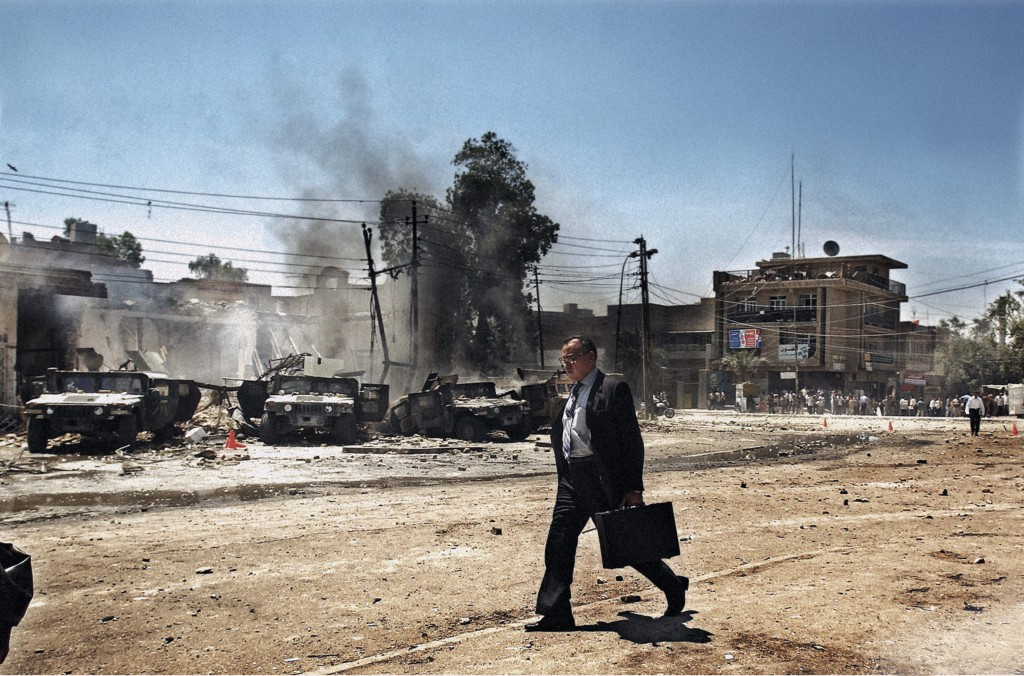 Baghdad, April 2004. An Iraqi man walks by the scene of an attack on US Army Humvees that caused several American casualties in the Al-Waziriyah neighbourhood of Baghdad. Photo by Moises Saman/MAGNUM