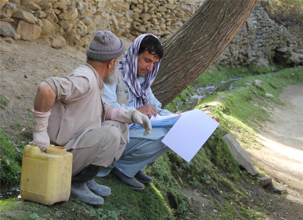 Enumerator from Berghof partner organization in Afghanistan interviewing a farmer.