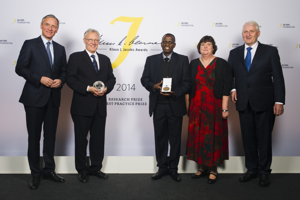 From left to right: Christian Jacobs; 2014 research prize recipient Michael J Meaney; 2014 best practice prize recipients: Philipp Chimponda, Beth McKenna and Father Baxter of SHARPZ.