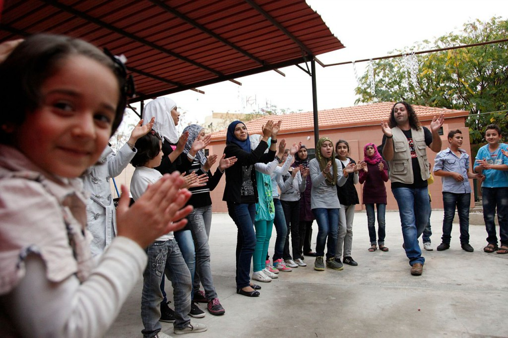 Syrian children play games at a social centre in northern Lebanon run by War Child Holland and UNICEF