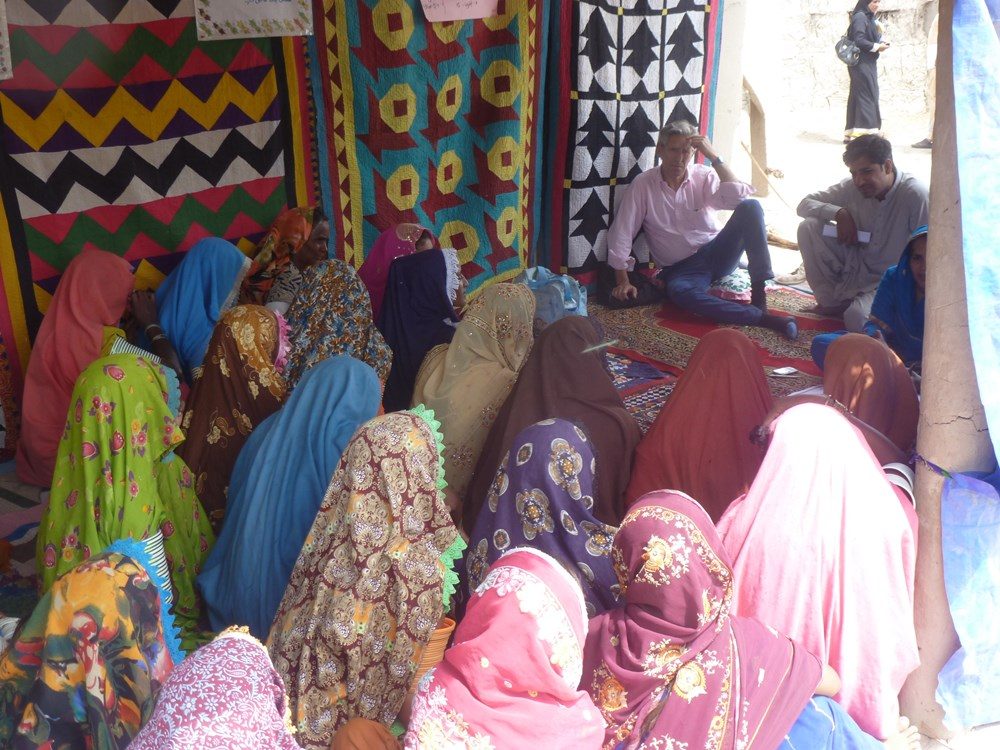 Nick van Praag of Keystone's Ground Truth project meets with locals of Pakistan's Sindh Province in 2013 to see if they're satisfied with efforts to help them recover from floods.