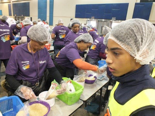 Hollard volunteers participate in a food‑packaging event in celebration of Nelson Mandela Day, in partnership with Stop Hunger Now.