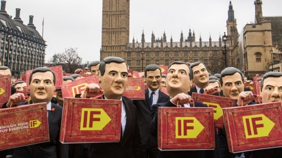 Protestors dressed as UK Chancellor George Osborne call for action on hunger as part of CAFOD's IF campaign. Many argue the UK Lobbying Act restricts such campaigning activities in the run‑up to elections.