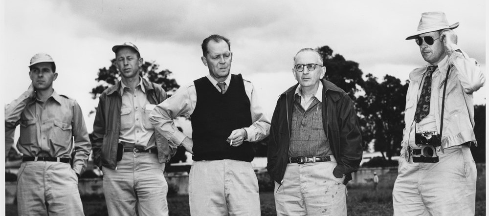Warren Weaver, the Rockefeller Foundation director for natural sciences and agriculture, visits the Mexican Agriculture Programme, Chapingo, Mexico, 1953. Programme officers John Niederhauser, George Harrar and Weaver are in the centre, left to right.