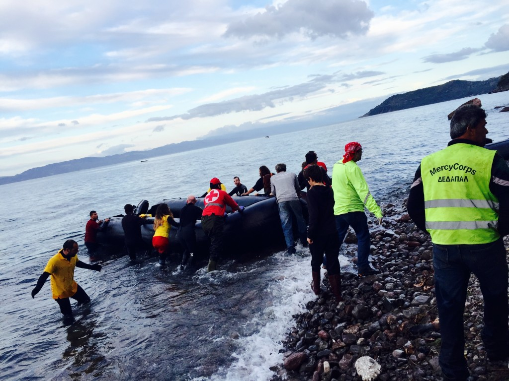 Volunteers pulling out a boat on the shore after having removed all the passengers safely. Credit Sofia Kouvelaki