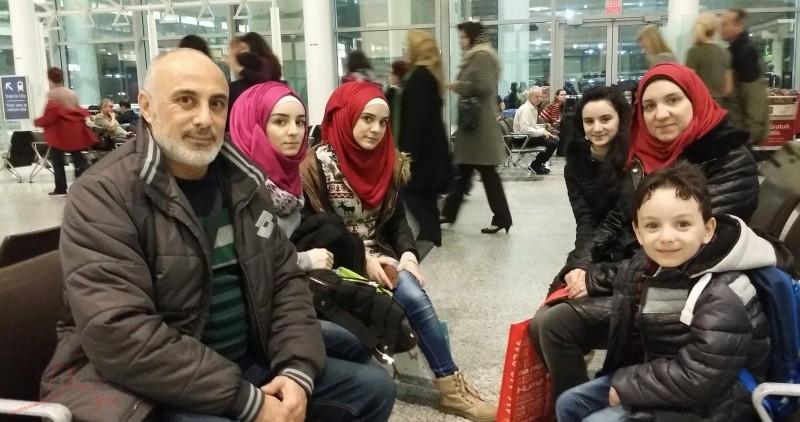 Caption: Syrian refugees arrive in Toronto, December 2015. Credit James Sarmiento.