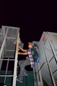 Migrant climbing on the Beast. Credit: Sanjuana Martinez.