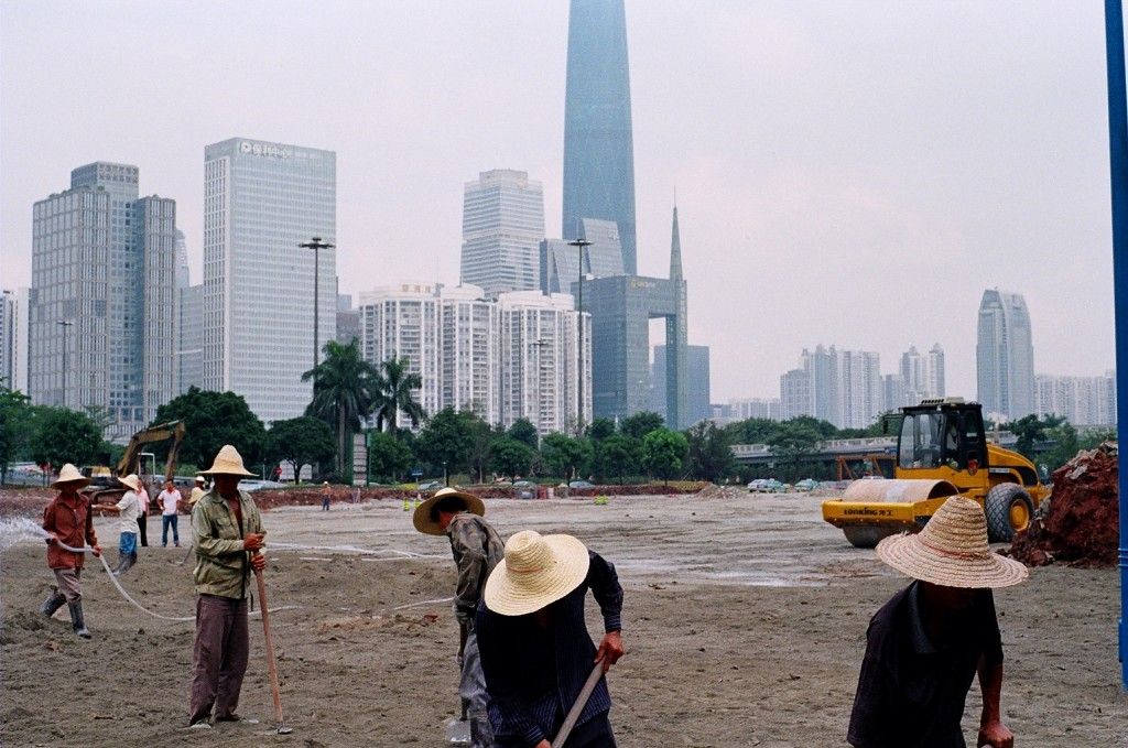 China has seen recent massive internal migration to urban centers in search of economic opportunity. Here construction workers from the countryside labour in front of Guangzhou's glittering skyline.