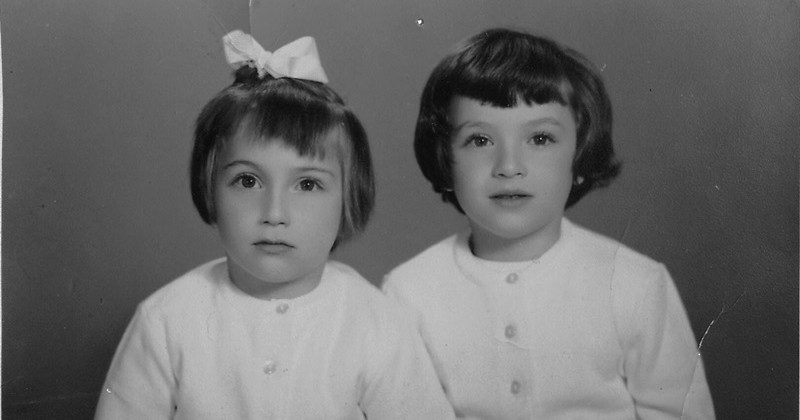 Bassma Kodmani (left) aged six or seven with her sister Hala, now a journalist.