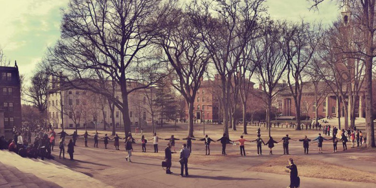 Divest Harvard encircles Harvard Yard during Harvard Heat Week in April 2015.