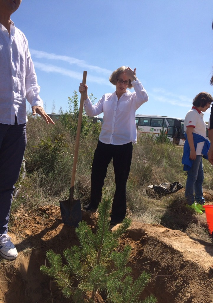 Planting trees with the Lao Niu Foundation team at their reforesting project in Inner Mongolia.