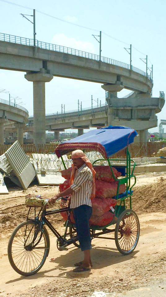 Two faces of Delhi: flyover construction and cycle rickshaw delivery man (left). Right: art installation in a five-star hotel.