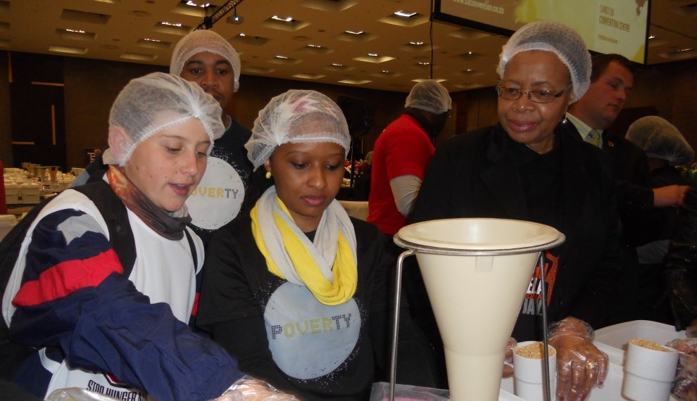 Graca Macel working with members of the Southern Africa Team trust