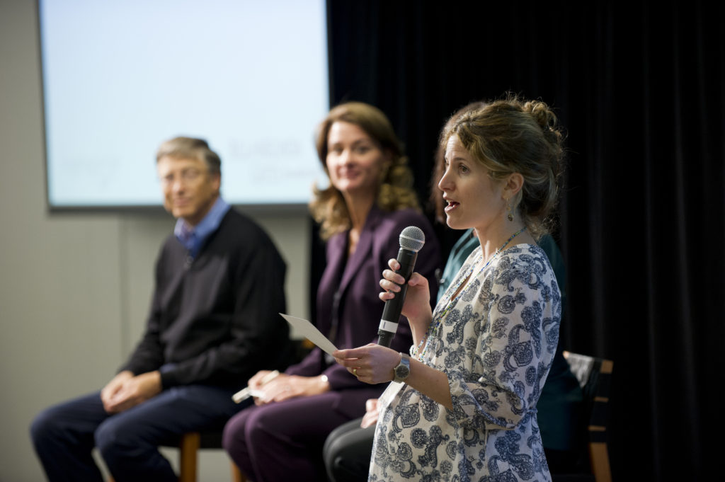 Giving Pledge founder Olivia Leland on a panel with Bill and Melinda Gates.