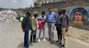 Topping meets members of the Mathare Social and Ecological Justice Network in Nairobi, Kenya.