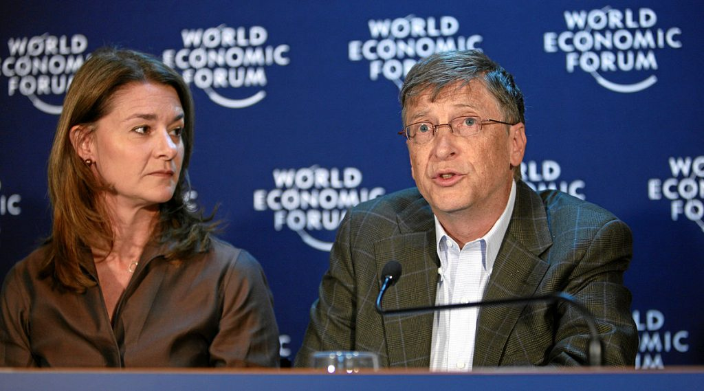 Melinda French Gates (left) looks at Bill Gates (right) during a speech at the World Economic Forum in 2009